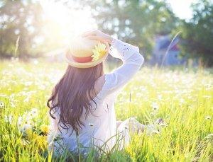 Woman sunbathes