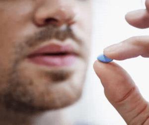 Man takes Viagra pill